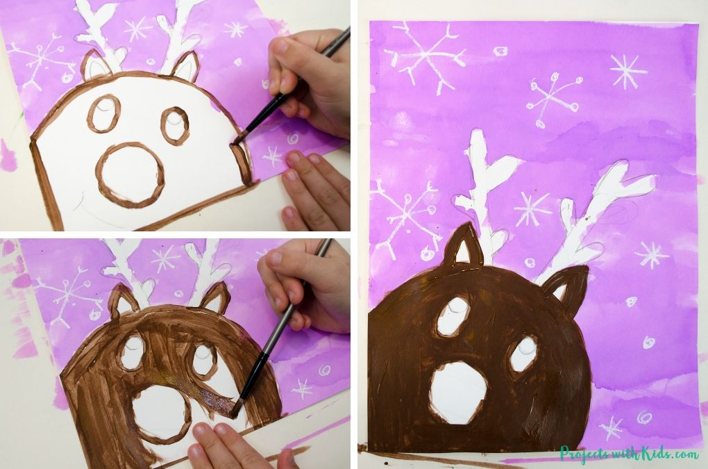 Painting a reindeer with brown acrylic paint.