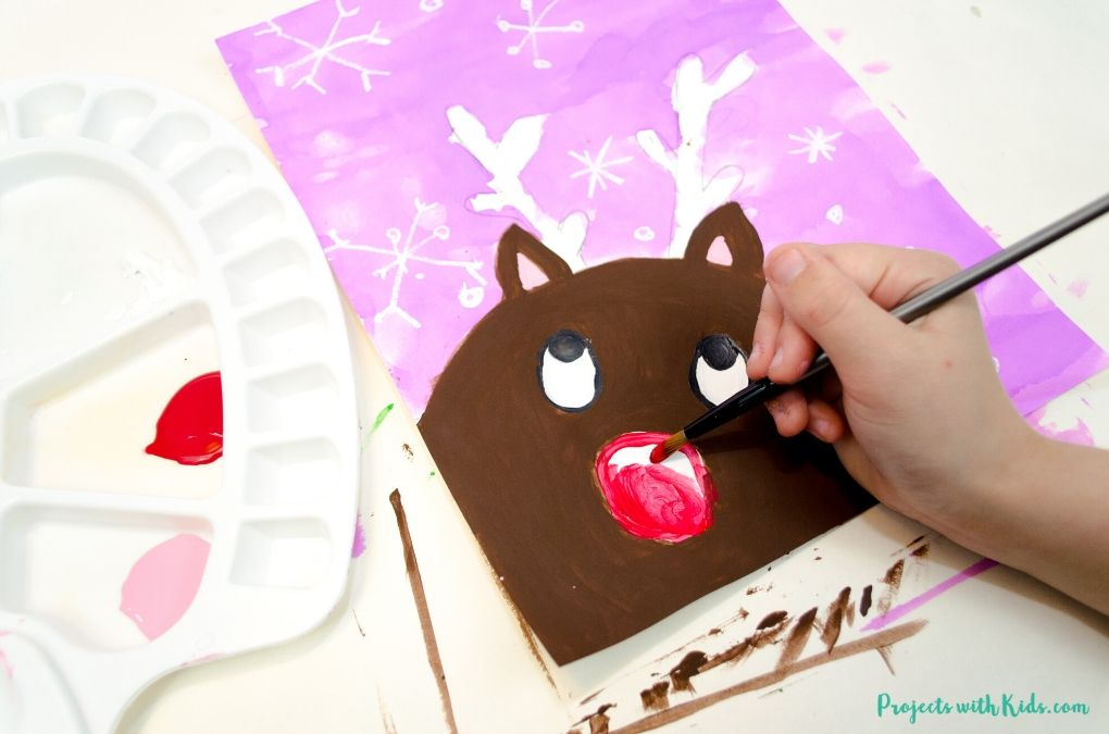 Painting on the eyes and nose on a reindeer.