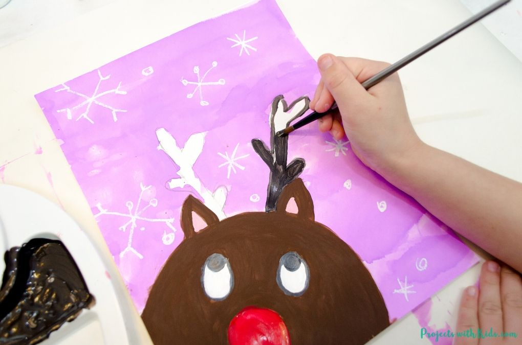 Painting on antlers on a reindeer painting.