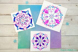 Snowflake mandala drawings using watercolor pencils