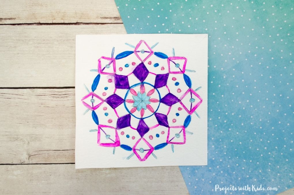 Snowflake mandala drawing using watercolor pencils