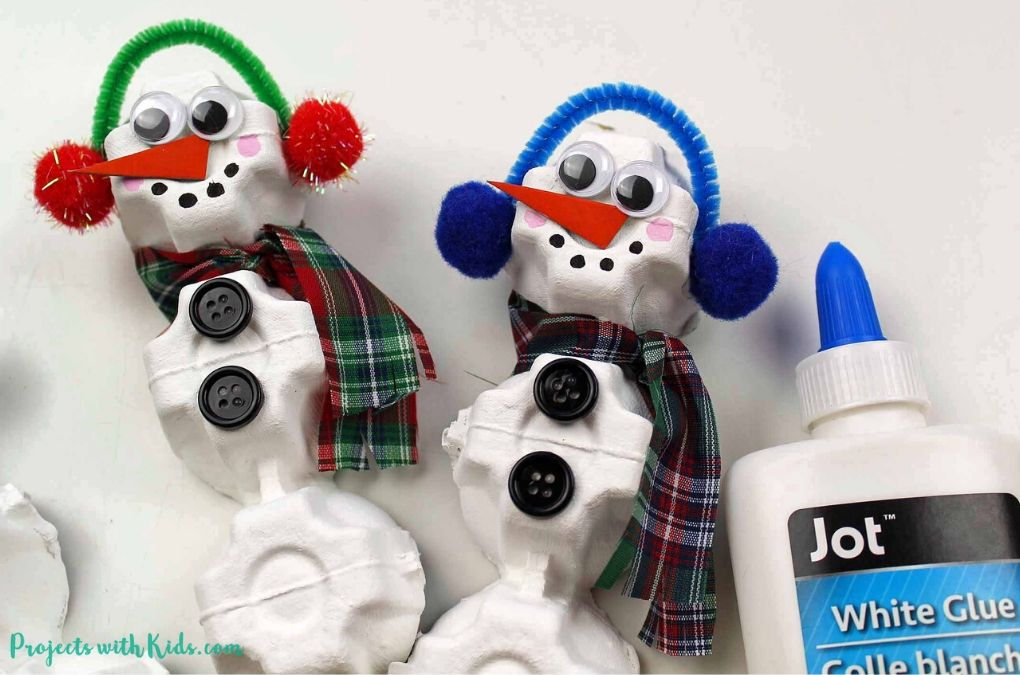 Snowman ornament craft for kids using egg cartons