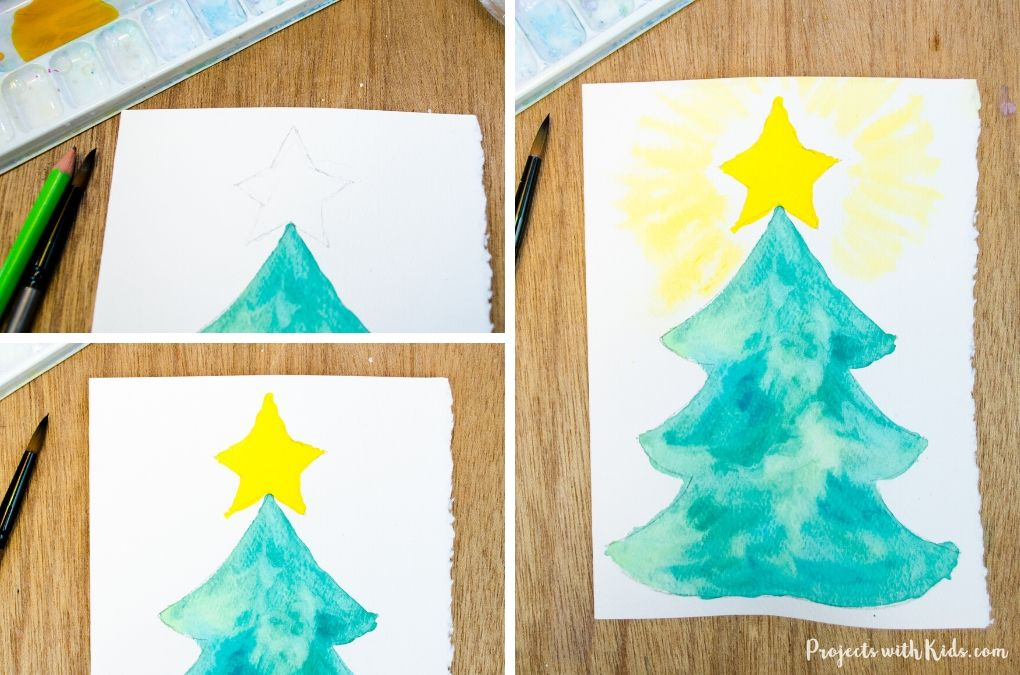 Painting a star on the top of a Christmas tree for a handmade Christmas card.