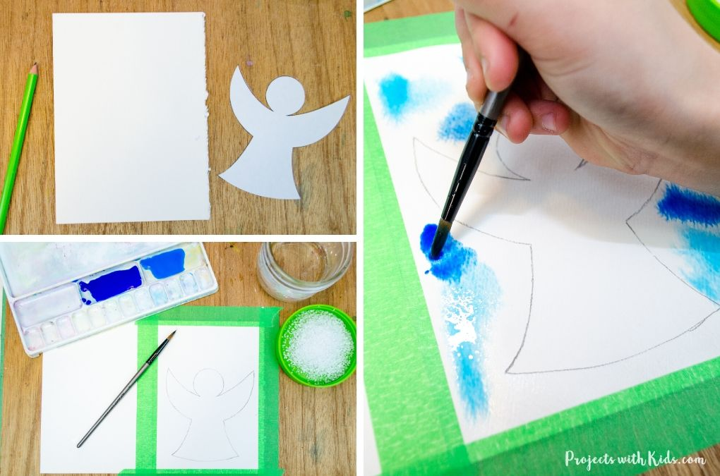 Drawing and painting an angel with blue paint on watercolor paper for a DIY Christmas card.