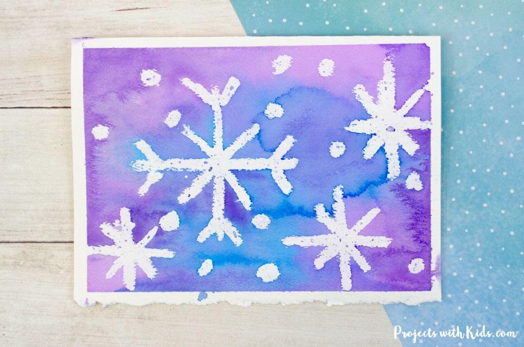 Snowflake watercolor resist Christmas card.