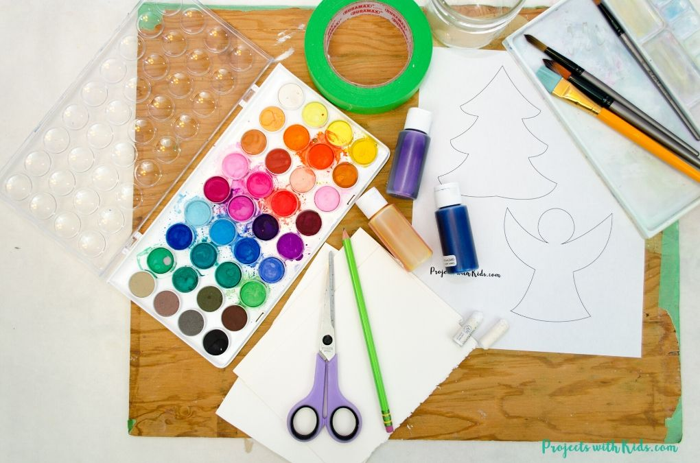Supplies needed to make watercolor Christmas cards.