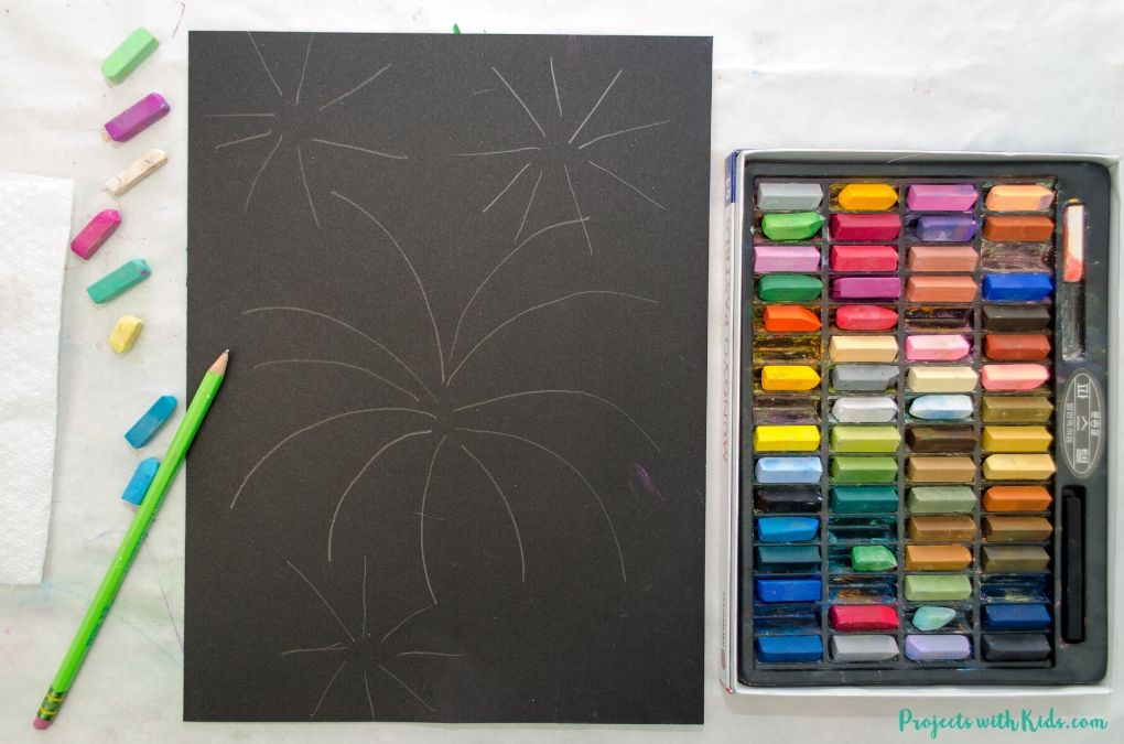 Drawing fireworks on black paper.