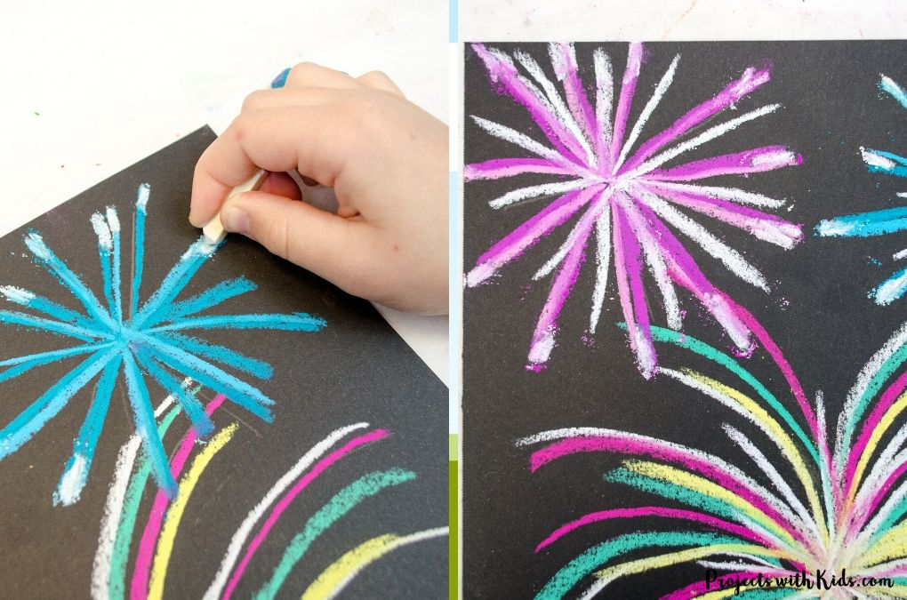 Drawing fireworks using chalk pastels on black paper.