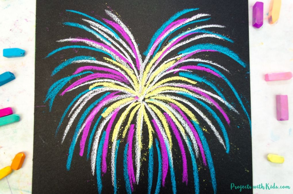 Yellow, pink, blue and white firework drawn with chalk pastels on black paper.