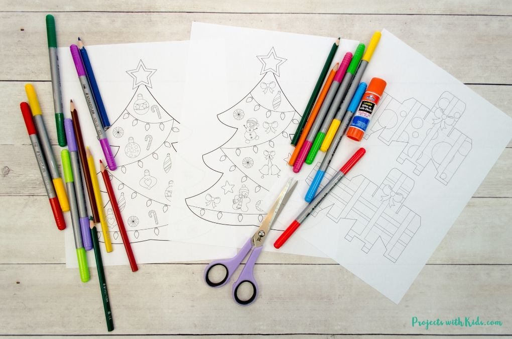 Christmas tree and presents printable, markers, pencil crayons, scissors, gluestick.
