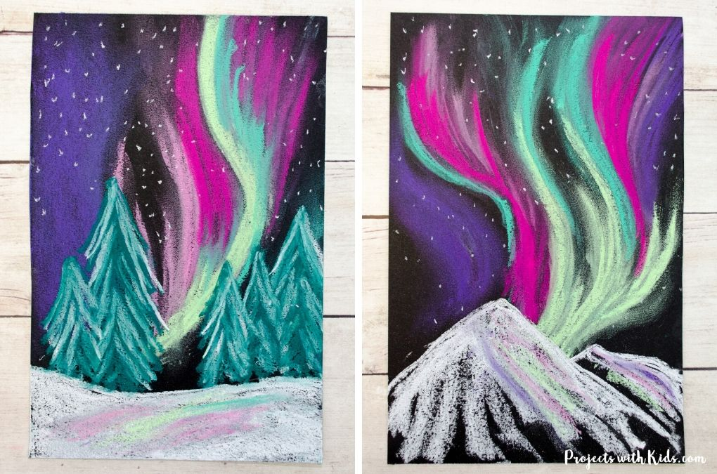 Finished image of two winter northern lights chalk pastel paintings.