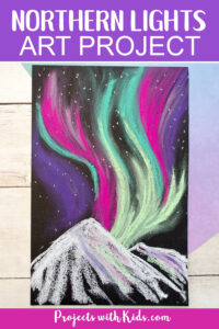 Snowy mountains northern lights art project for kids to make.