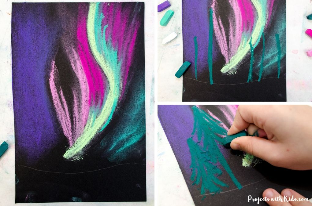 Adding trees to a northern lights painting for kids.