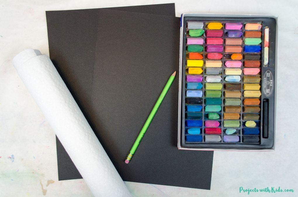 Chalk pastels, black paper, paper towels and a pencil.