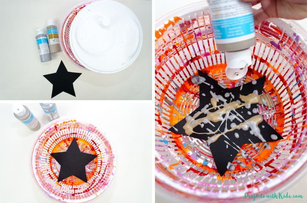 Spin art with gold and silver paint on black stars.