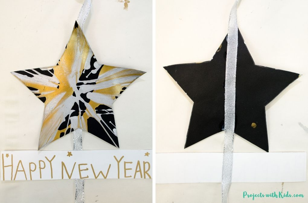 Glueing together a New Year's Eve banner with heart cut outs and silver ribbon.