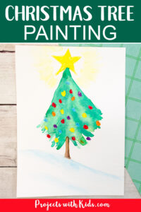 How to paint a Christmas tree with watercolor paint and oil pastels.