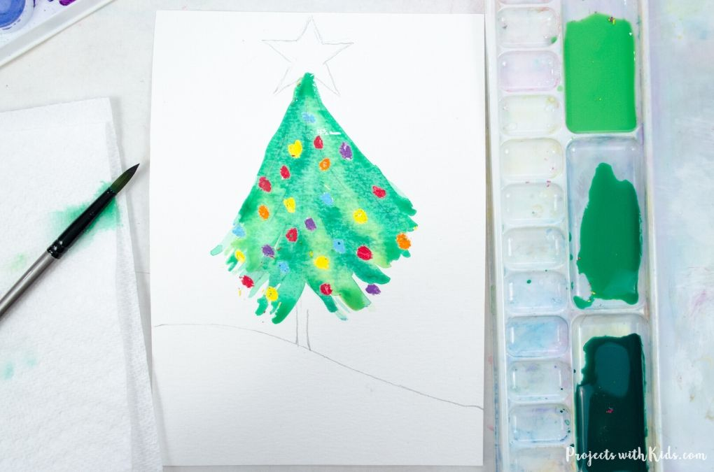 Painting a watercolor Christmas tree.