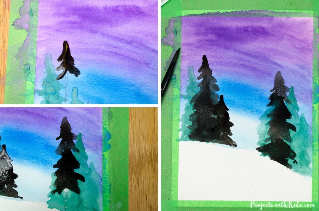Painting in darker evergreen trees to a winter scene painting.