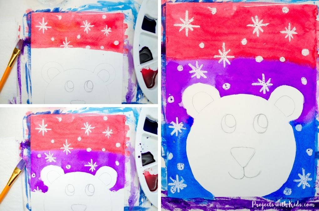 Painting red, purple and blue watercolor wash on a winter polar bear painting