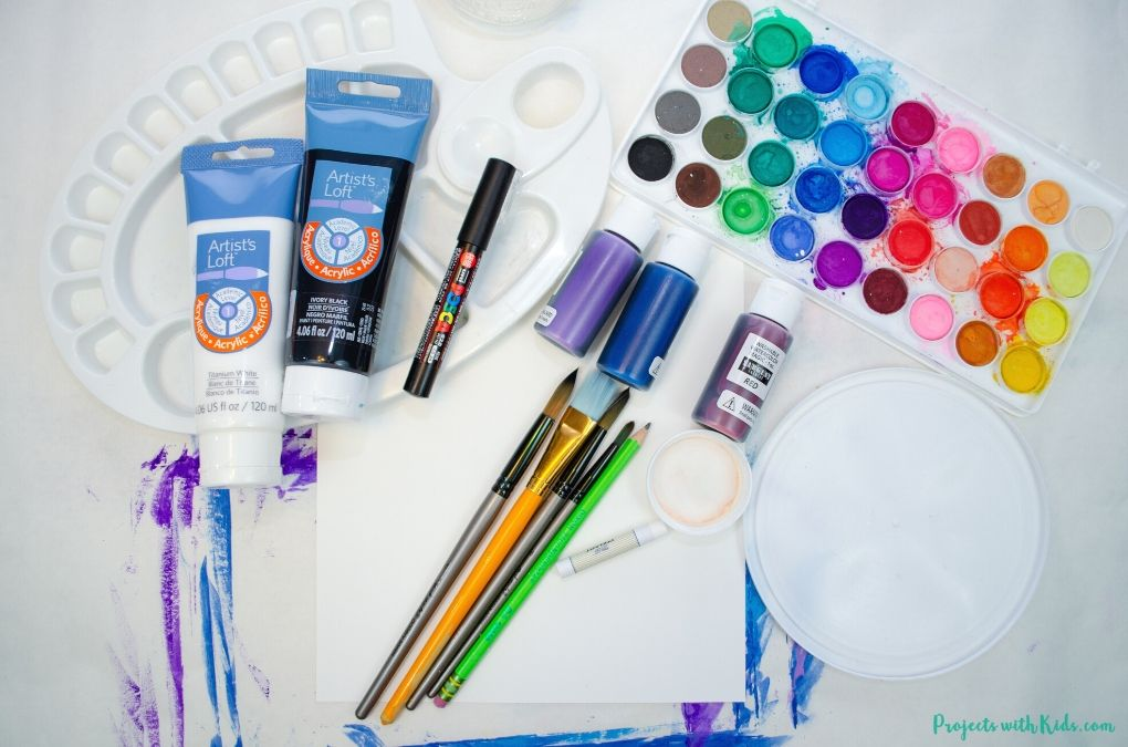 Supplies needed to create a polar bear painting for kids