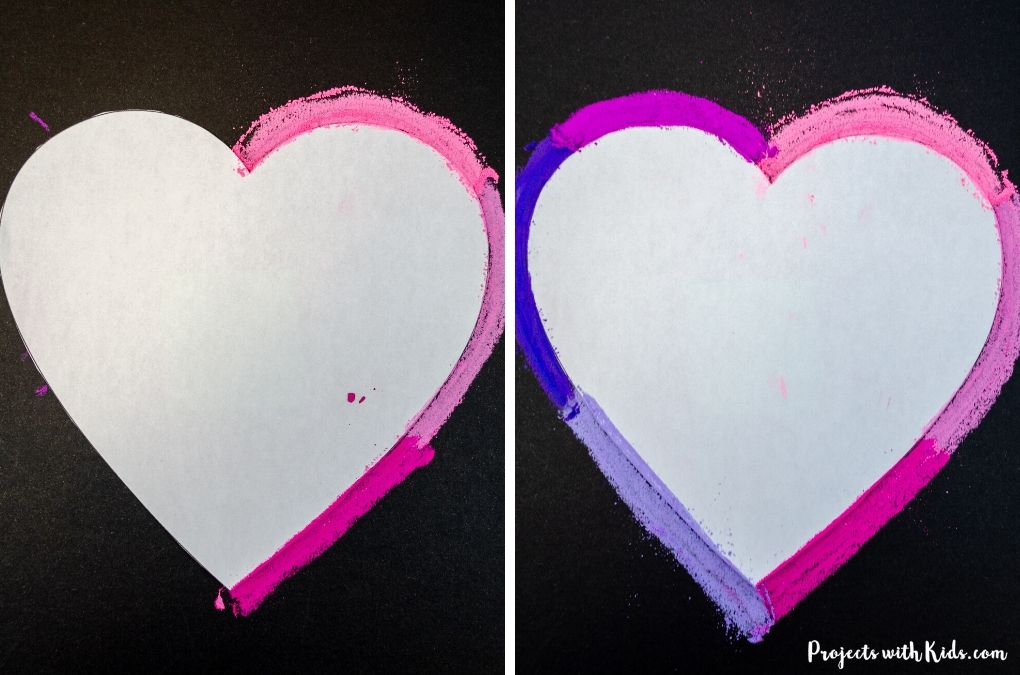 Drawing around a heart template with chalk pastels