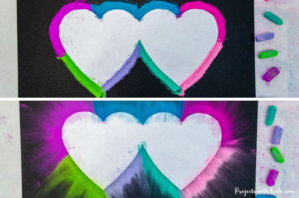 Chalk pastel heart art with bright colors on black paper