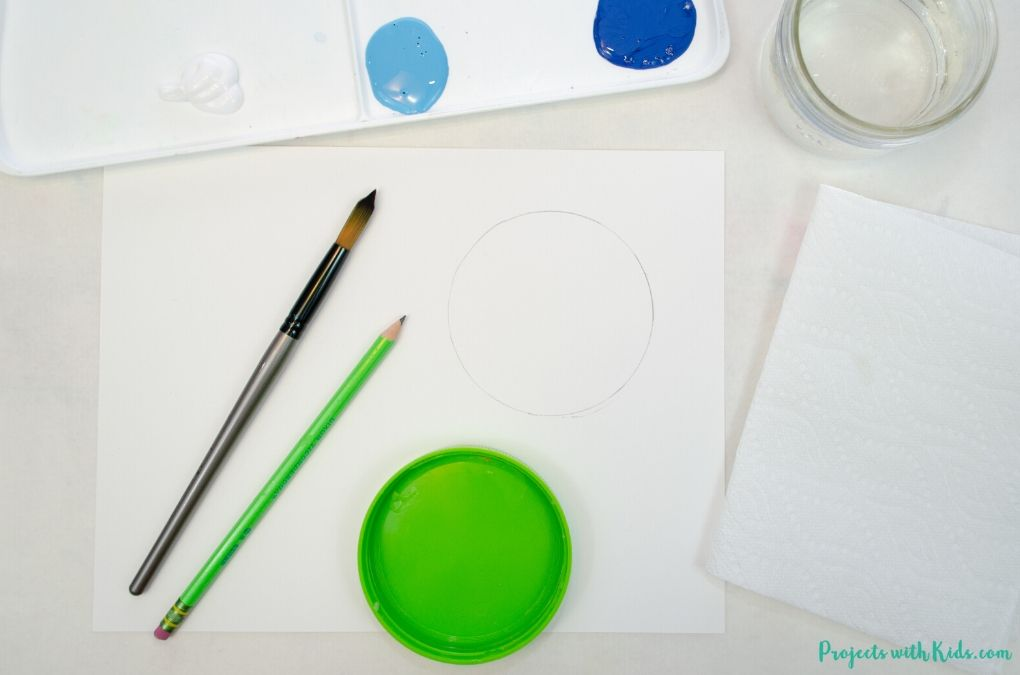 Drawing a circle with a template onto white paper