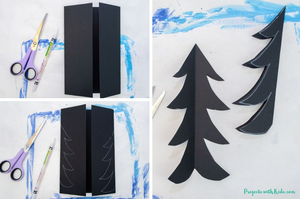 Cutting out evergreen trees from black cardstock.