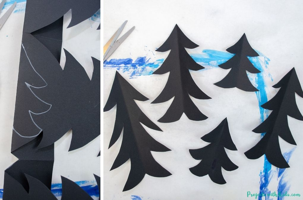 Evergreen trees cut out of black paper