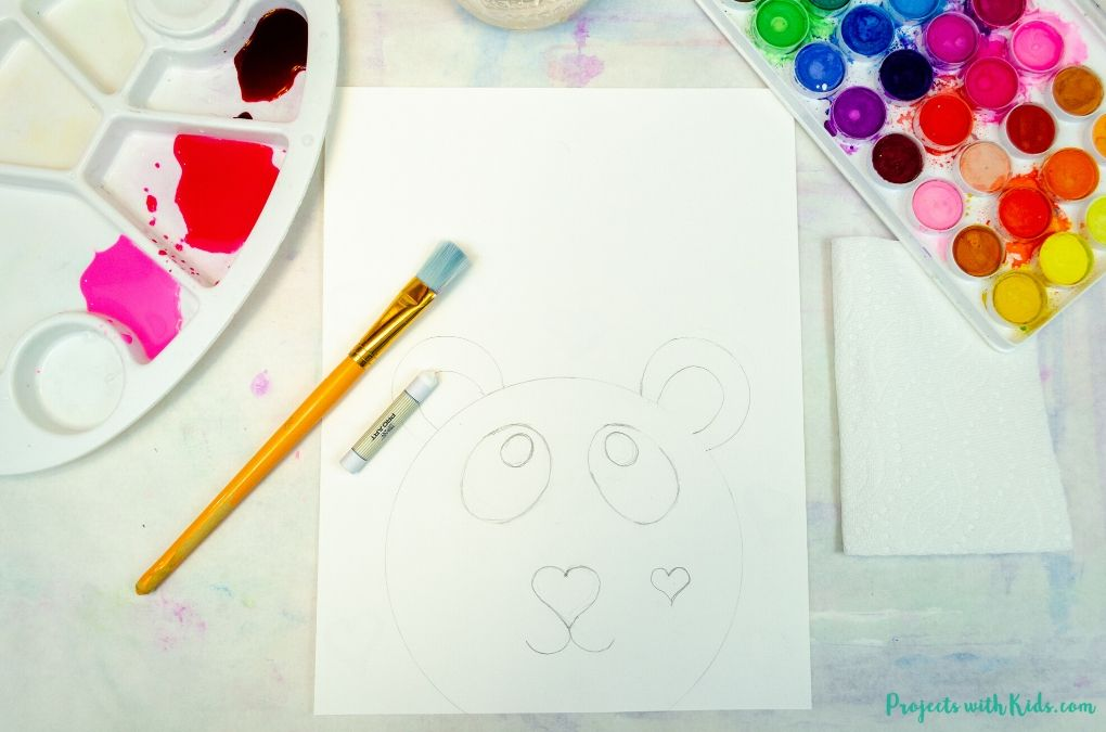 Drawing hearts with white oil pastel on white cardstock