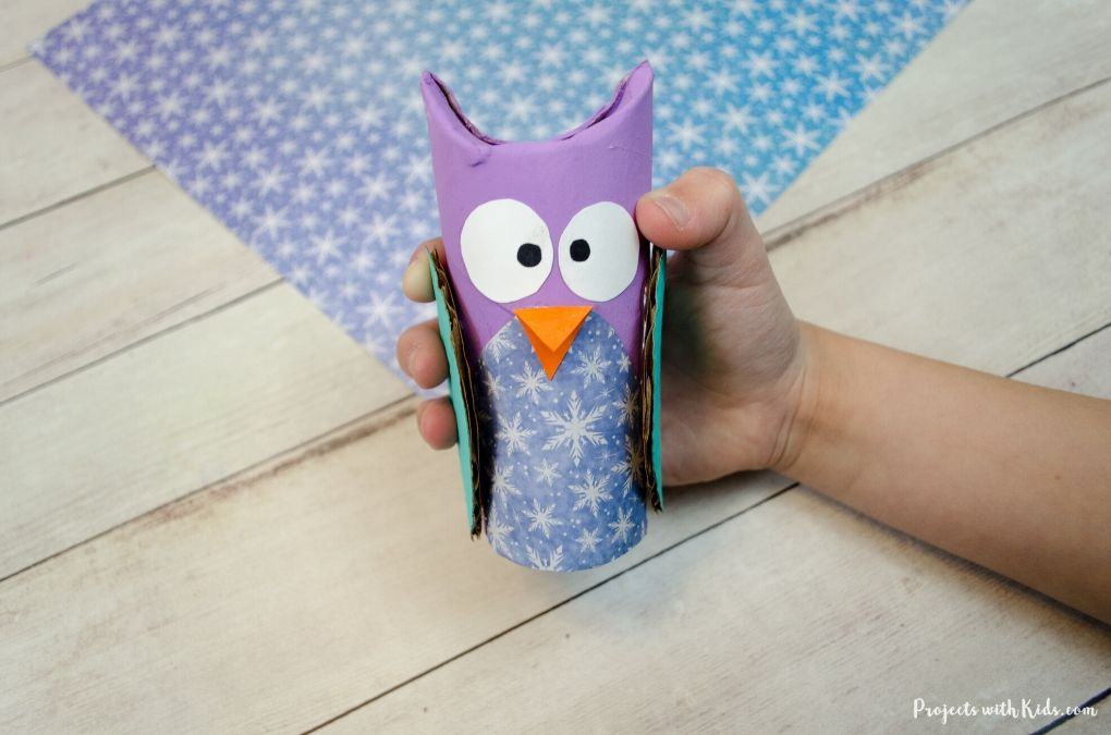Purple and snowflake patterned paper owl craft project.