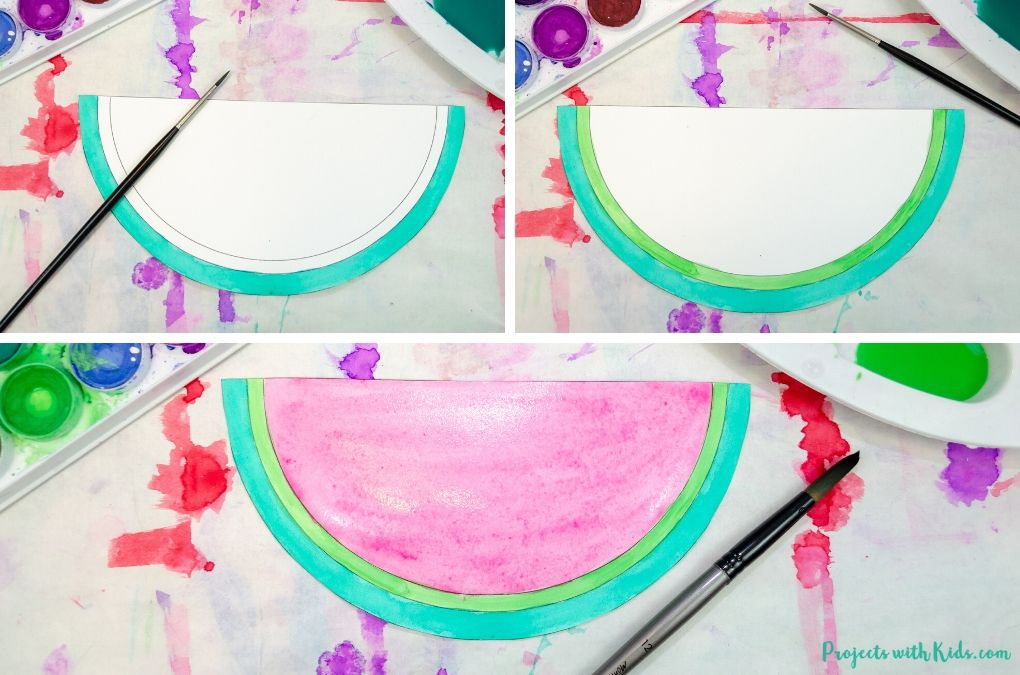 Using watercolors to paint a watermelon paper craft