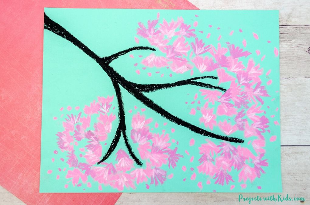 Finished image of a chalk pastel cherry blossom art project for kids to make