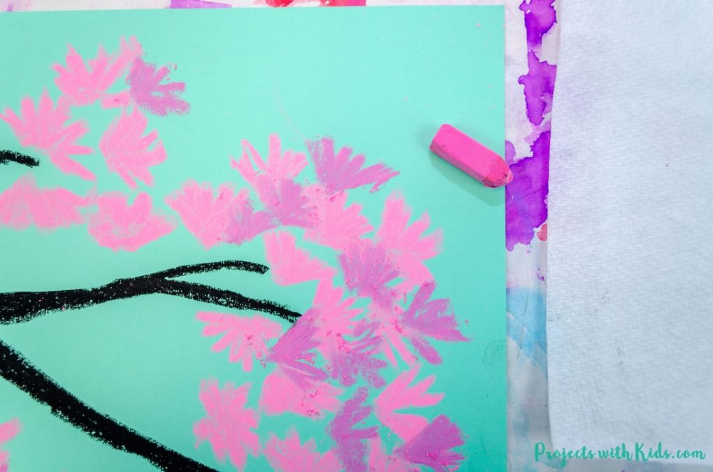 Adding in dark pink to a cherry blossom art project
