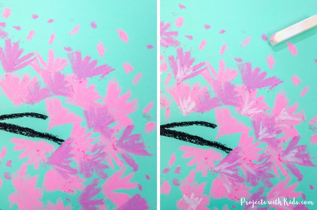 Adding detail to a chalk pastel cherry blossom spring art project for kids