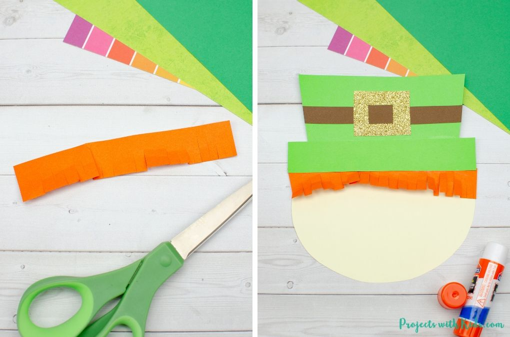 Glueing together a St. Patrick's Day craft.