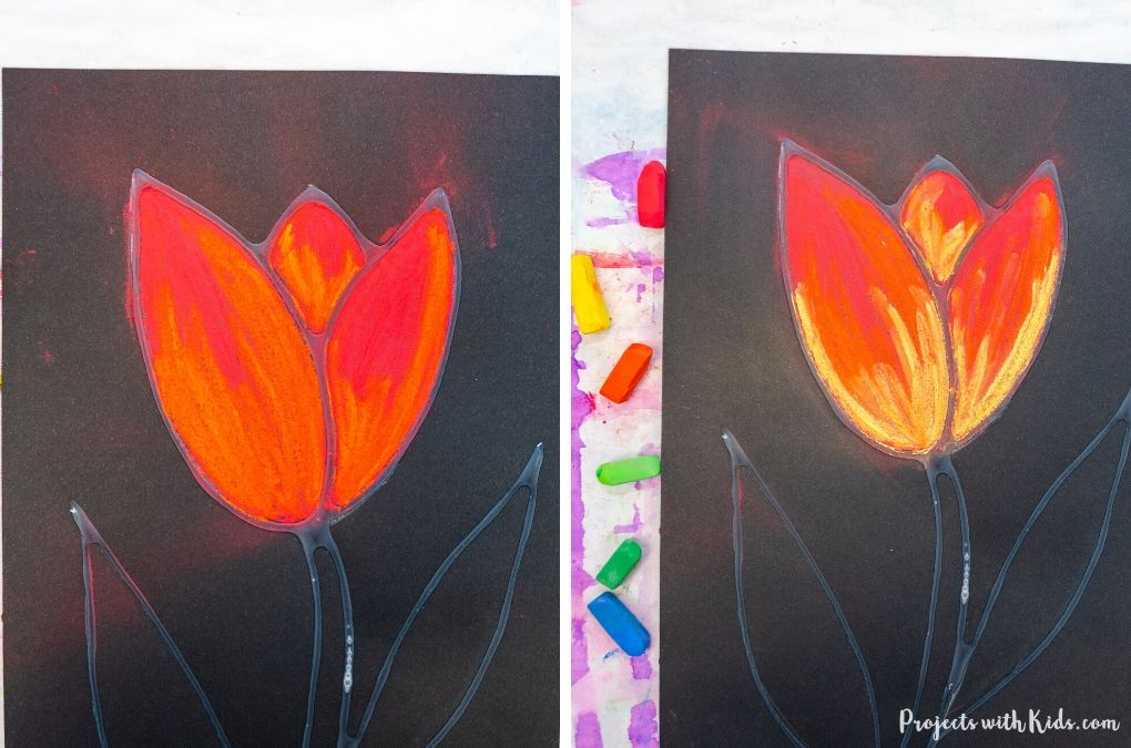 Adding orange and yellow chalk pastel to a tulip art project for kids.