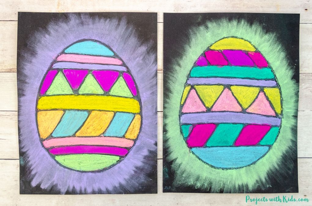 Chalk pastel easter egg art on black paper for kids to make.