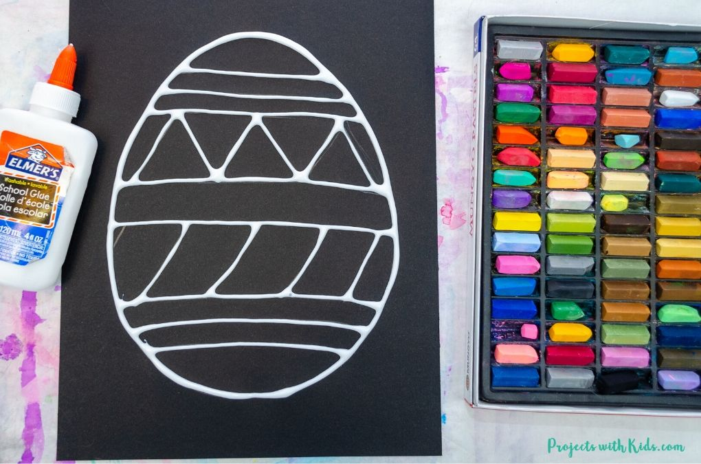 Tracing an easter egg drawing with white glue.