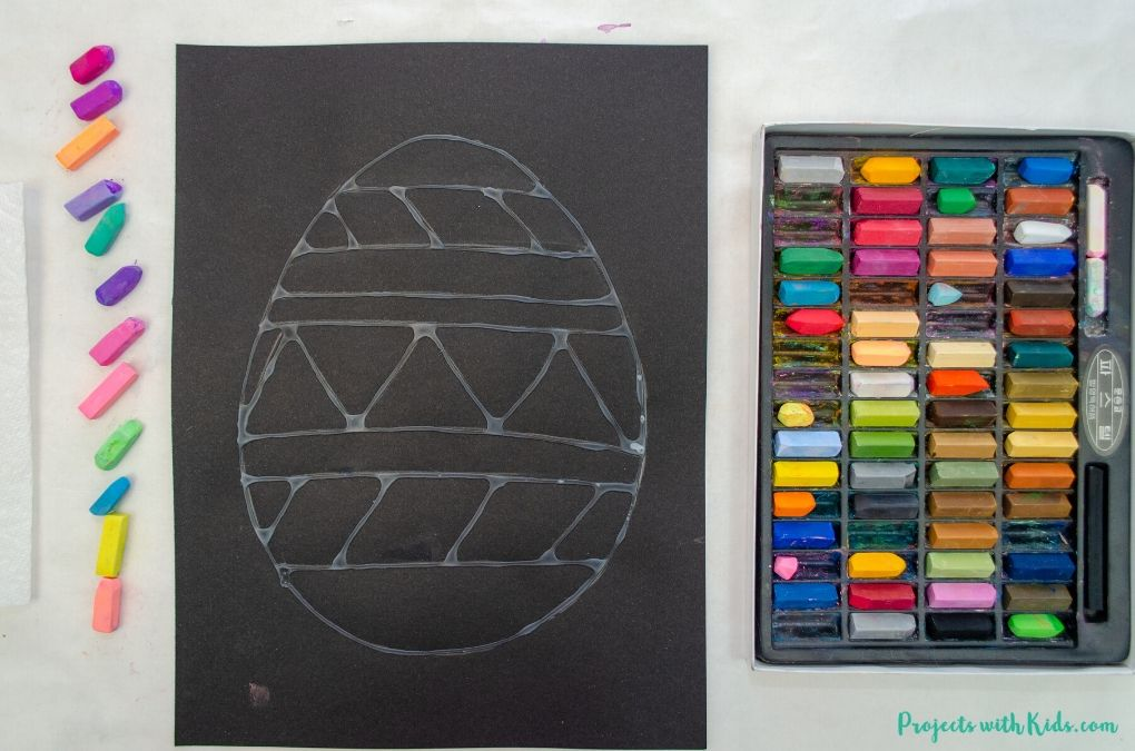 Black paper and chalk pastels.