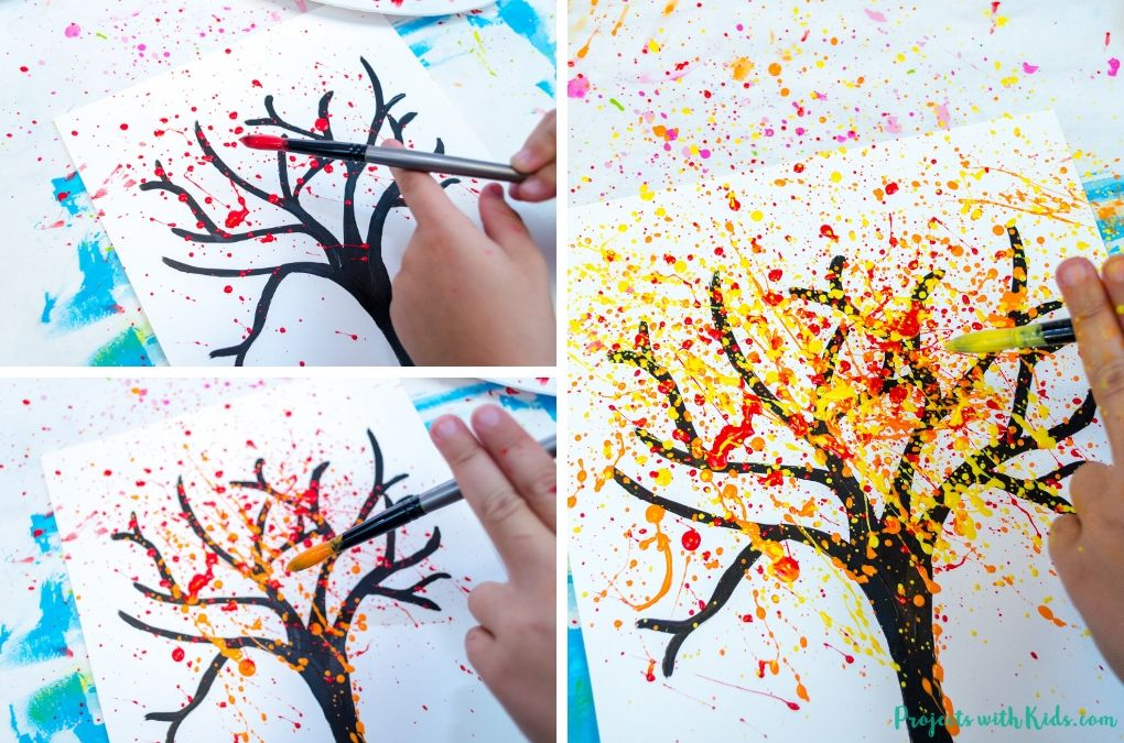 Splatter painting with red, orange and yellow paint to make a fall tree painting.