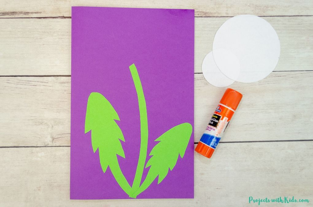 Glueing on leaves for a dandelion craft