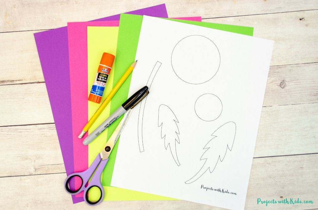 Supplies needed for a paper dandelion craft Mother's Day card