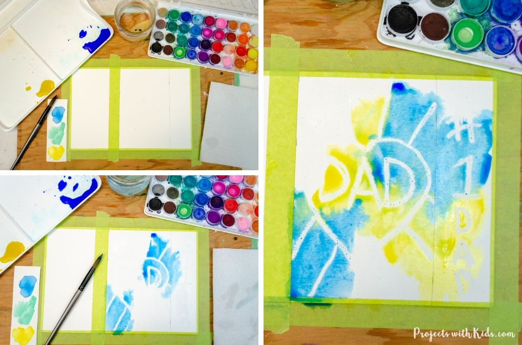 Painting with blue and yellow watercolors for a Father's Day bookmark and card craft.