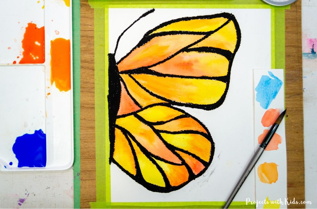 Finished painting butterfly wings with watercolor paint.