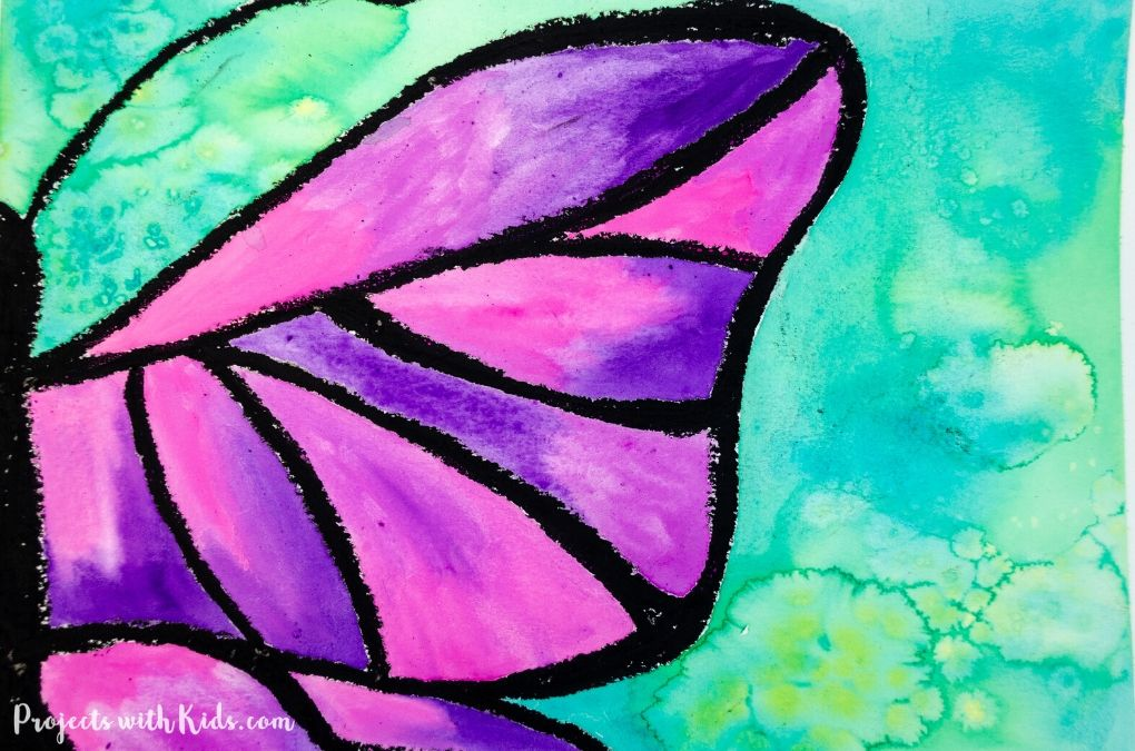 Purple butterfly painting with a green background using wet on wet and salt watercolor techniques.