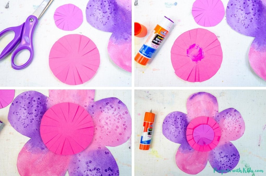 Cutting and glueing colored paper to a watercolor flower