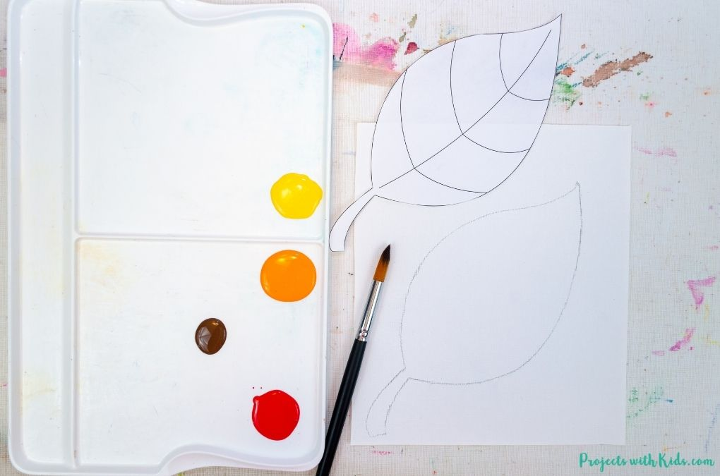 Tracing a leaf template onto paper.