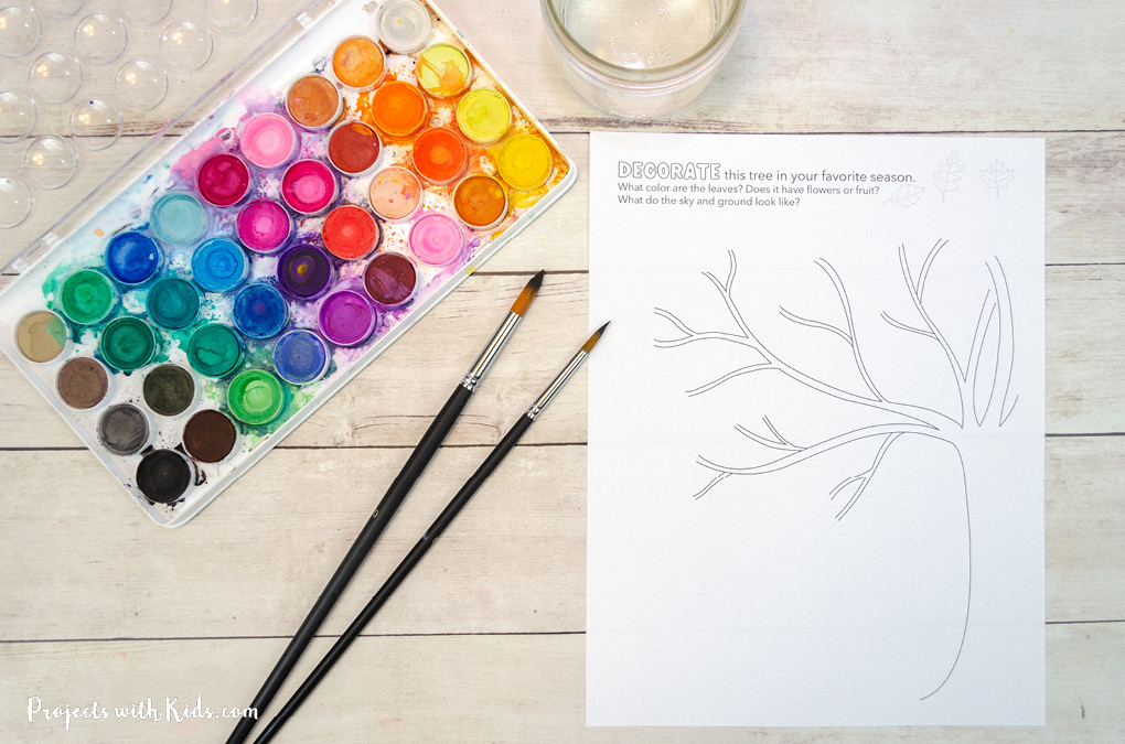 Printed drawing of a tree for kids to paint and detector with watercolors